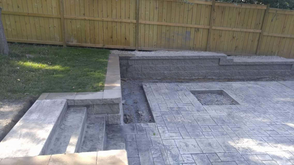 Retaining Wall on Patio with drain and firepit